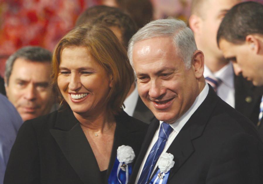 LIKUD PARTY leader Benjamin Netanyahu and Kadima Party head Tzipi Livni attend the swearing-in cerem