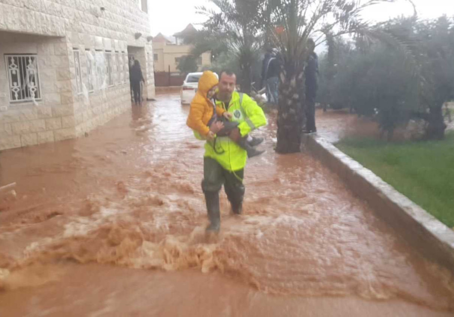 Firefighters rescued mother and son from flooded house.