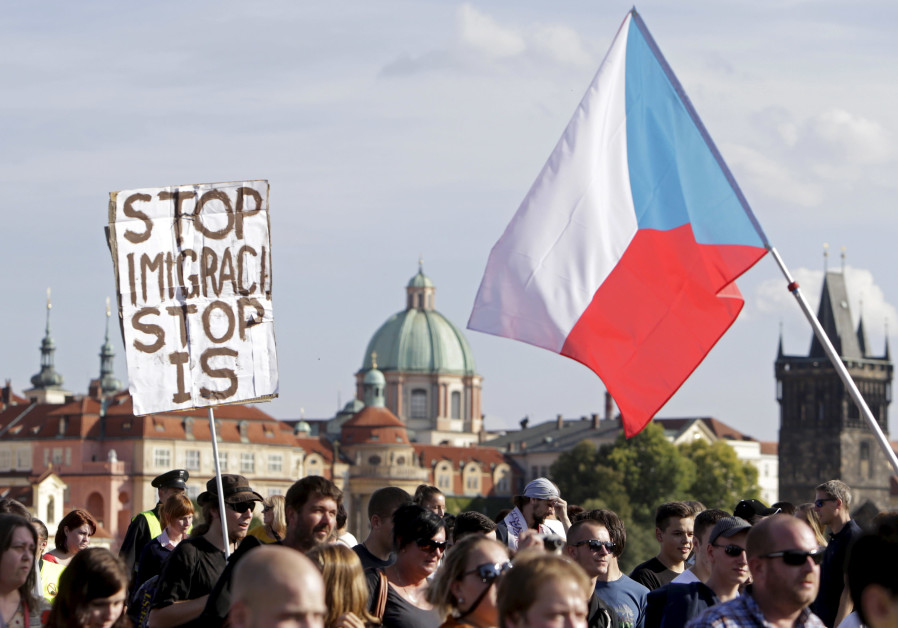 File photo of demonstrators marching during an anti-immigrants rally in Prague, Czech Republic, Sept