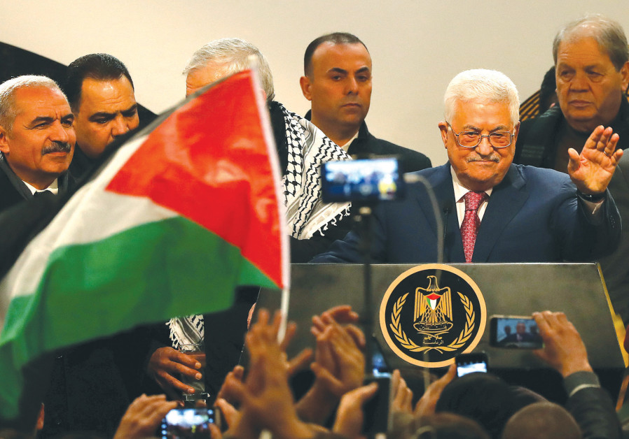 PALESTINIAN AUTHORITY PRESIDENT Mahmoud Abbas greets the audience during a ceremony in Ramallah