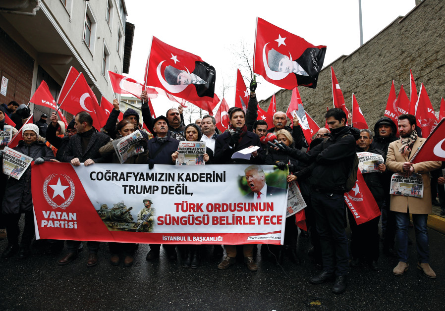 MEMBERS OF Vatan (Patriotic) Party wave flags of Turkey and of their party during a protest