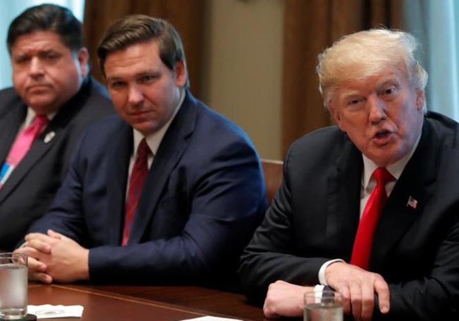 U.S. President Donald Trump meets with new U.S. governor-elect Ron DeSantis of Florida