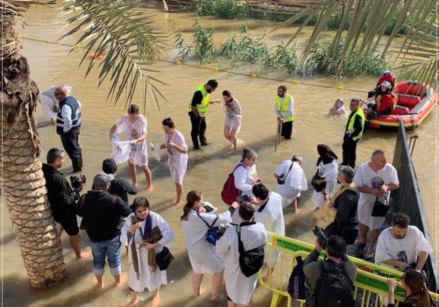 Pilgrims enter the Jordan River during the celebration of the Epiphany, Friday January 18 2019