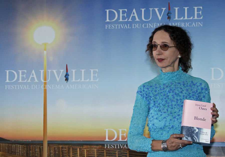 "Writer Joyce Carol Oates poses with her book ""Blonde"" during a photocall after she won the Literary"