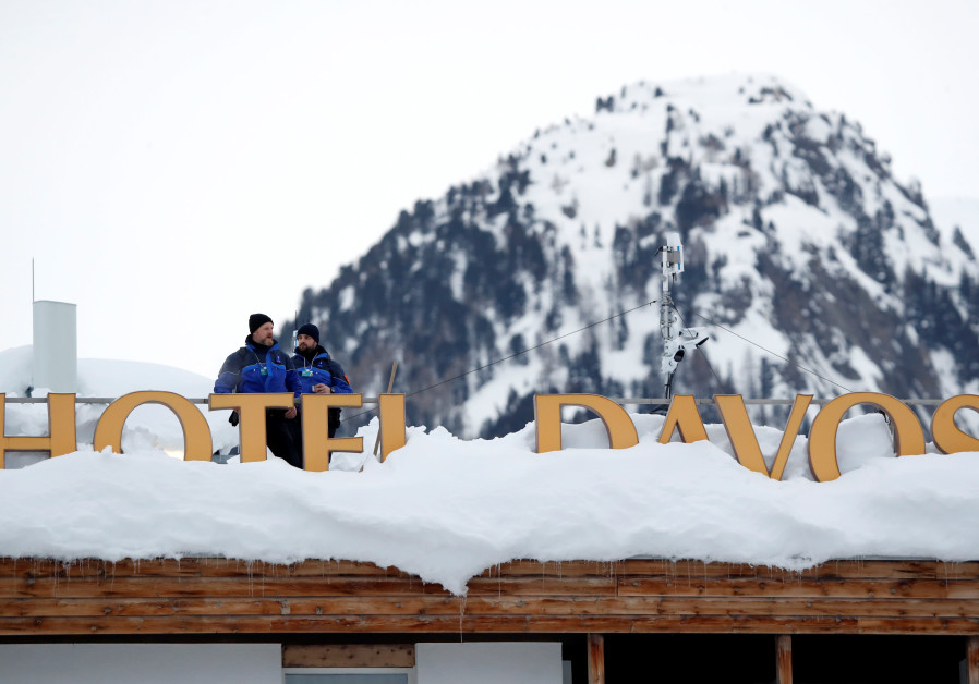 Policemen keep watch ahead of inauguration of World Economic Forum in Davos, Switzerland, 2019.
