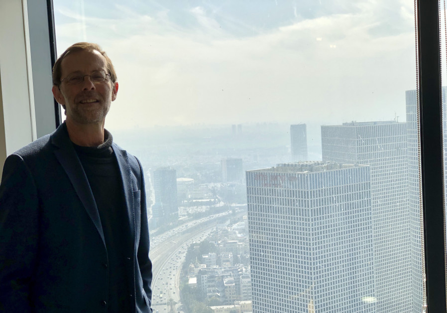 Moshe Feiglin, head of the Zehut party, in a meeting with a view of the Tel Aviv skyline.