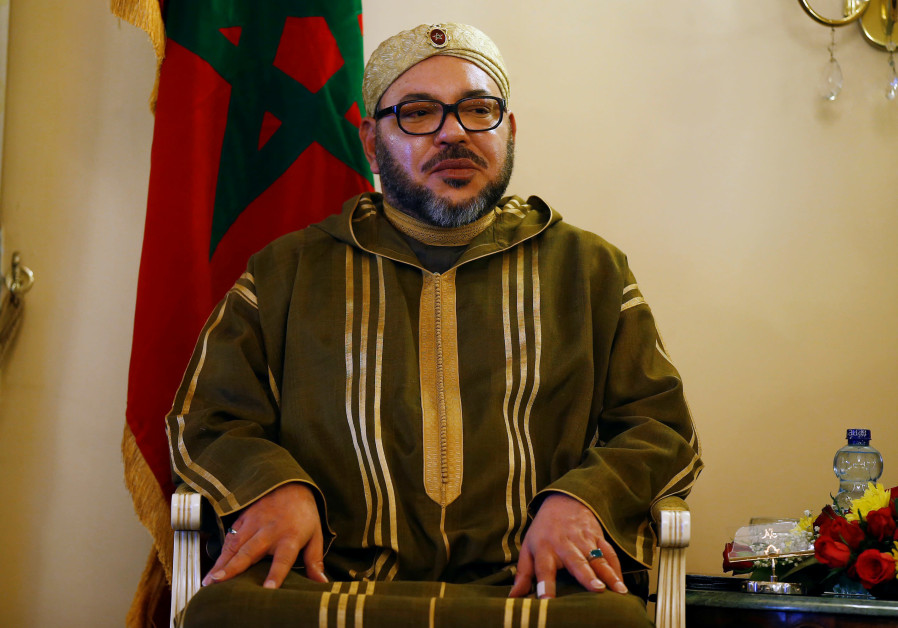 King Mohammed VI of Morocco reviews a guard of honour at the National palace during his state visit