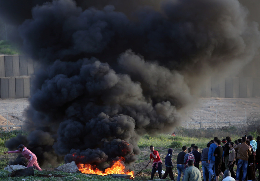 Palestinian demonstrators protest at the Israel-Gaza border fence, in the central Gaza Strip January