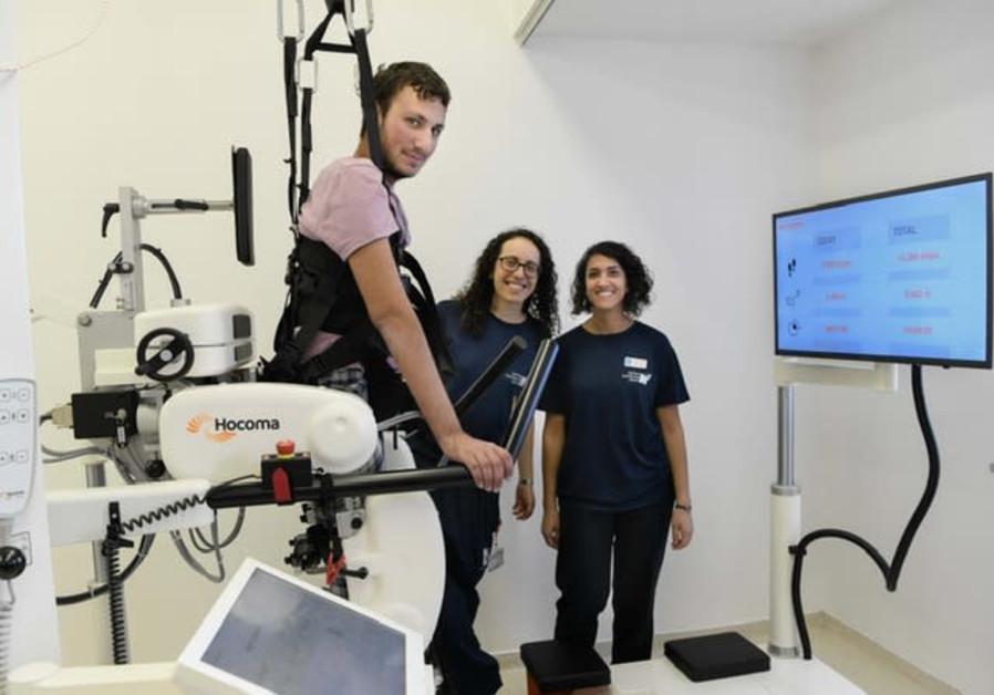 IDF combat soldier Dvir Teitelbaum uses Hadassah Hospital's new Lokomat robotic walking system