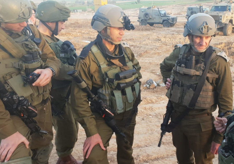 Head of IDF Southern Command, Maj.-Gen. Hertzi Halevy, meets an officer shot in the helmet by sniper