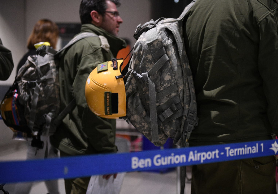 Members of an IDF Homefront Command delegation wait to board a flight to Brazil. (IDF Spokesperson's Unit)