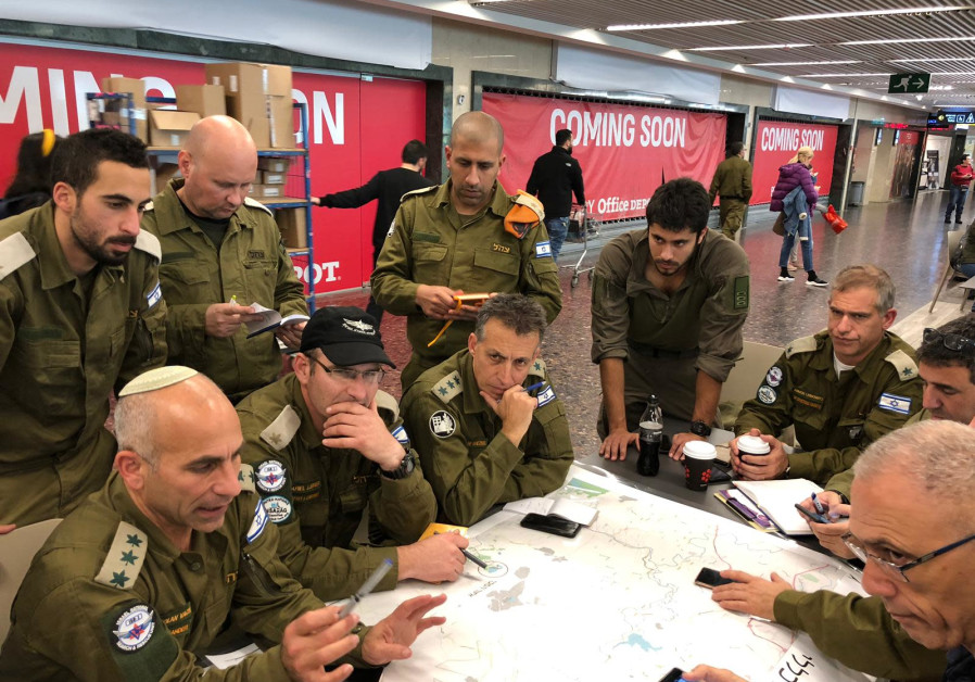 IDF Home Front Command officers are briefed before departing for Brazil for disaster relief on January 27, 2019