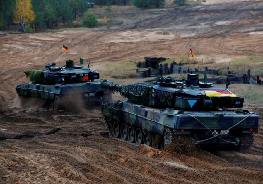 German Leopard 2 tanks of the NATO enhanced Forward Presence battle goup attend Iron Tomahawk