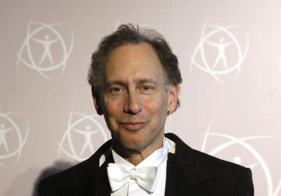 MIT Professor Robert Langer poses with the 2008 Millennium Technology Prize