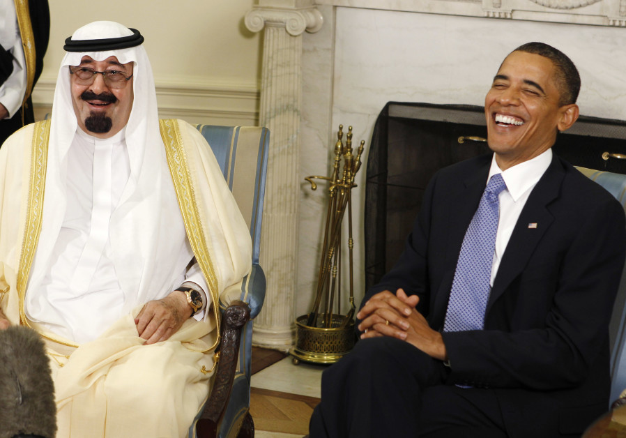 Barack Obama (R) laughs as he meets with King Abdullah of Saudi Arabia in the Oval Office