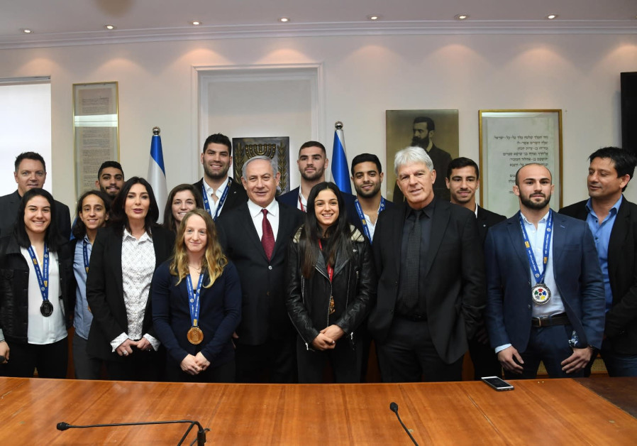 Benjamin Netanyahu and Miri Regev meet with medal winners of Grand Prix judo tournament.