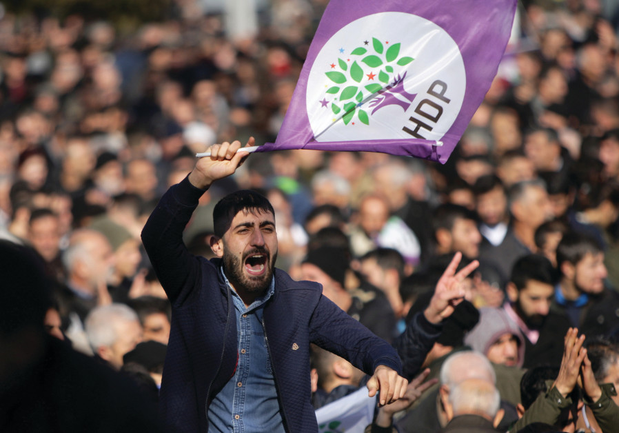 A SUPPORTER of the pro-Kurdish Peoples' Democratic Party protests earlier this month in