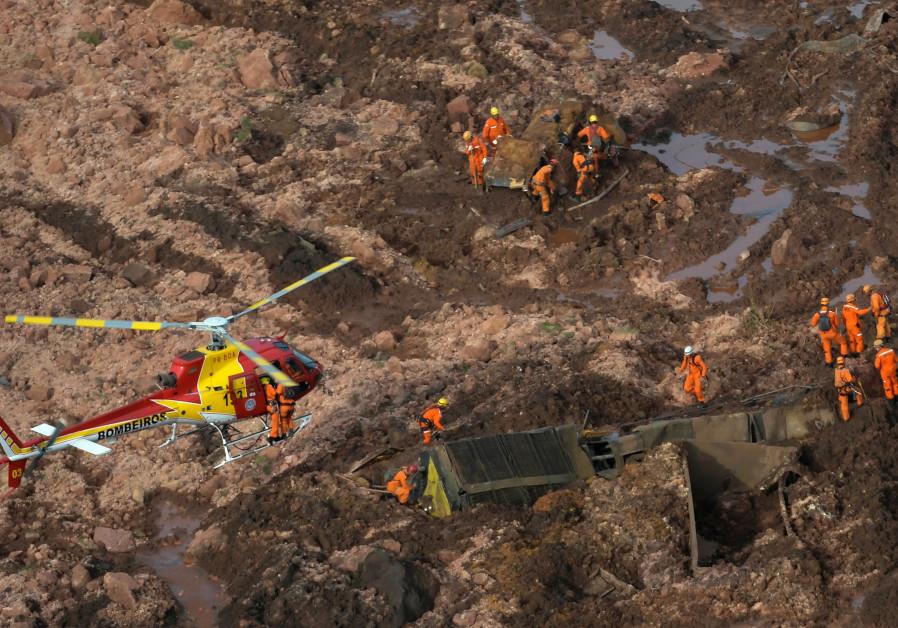 Rescue crew work in a dam that burst in Brazil