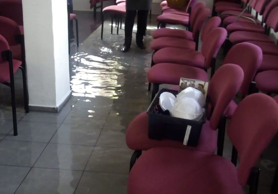 The flooded synagogue in Netanya after vandals inserted a hose through the window