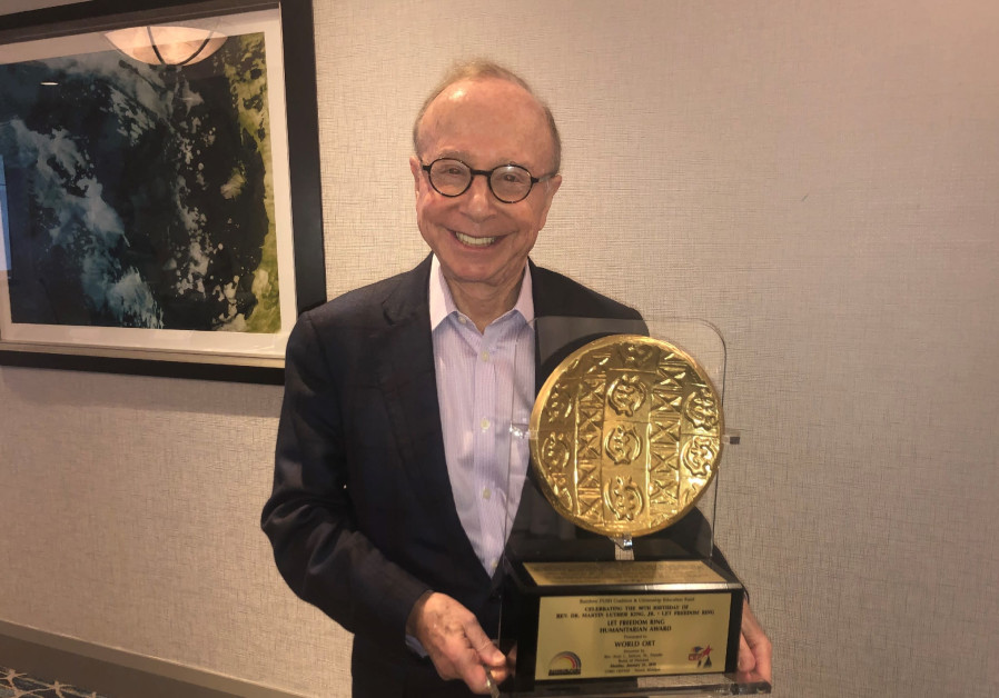 WORLD ORT president Dr. Conrad Giles holds the 'Let Freedom Ring Humanitarian Award'
