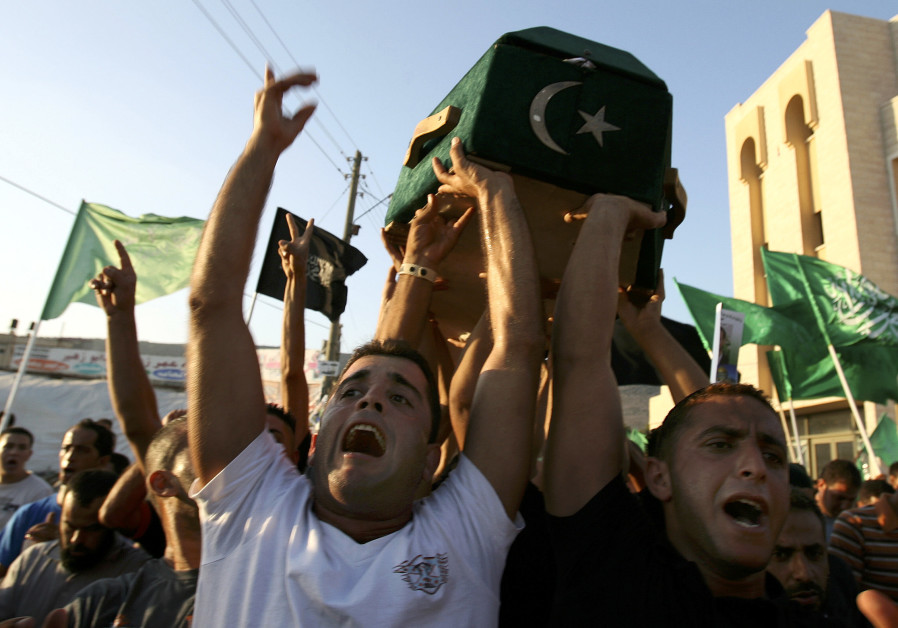 The coffin of Arab-Israeli Ahmad Al Khatib is carried by friends is carried by friends and relatives