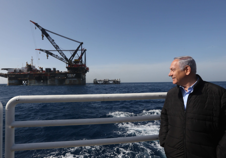 Prime Minister Benjamin Netanyahu looks on in front of the Leviathan gas platform