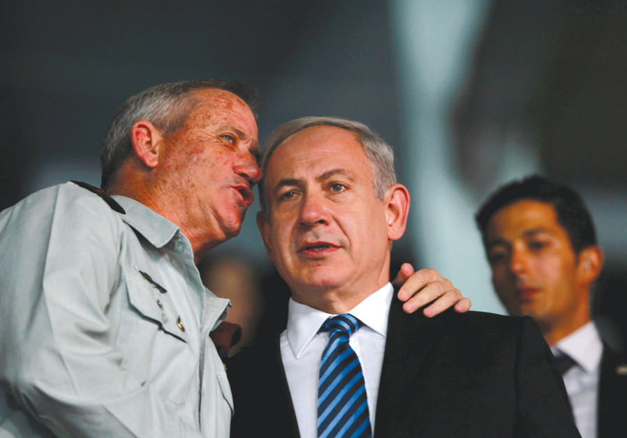 PRIME MINISTER Benjamin Netanyahu listens to then-IDF chief of staff Benny Gantz in 2013.