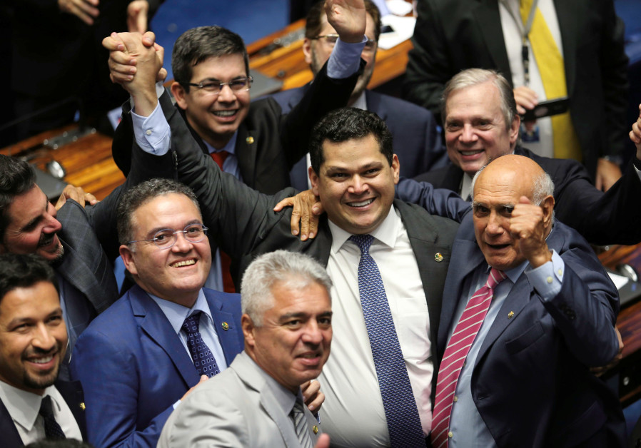 Davi Alcolumbre, from the Democratas party is congratulated by his colleagues after being elected fo