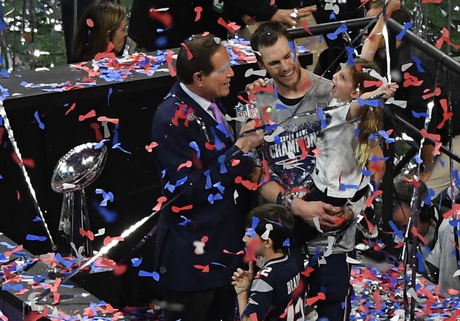 Atlanta, GA, USA; New England Patriots quarterback Tom Brady (12) celebrates with his daughter