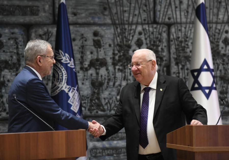 President Reuven Rivlin (R) shakes hands with Austrian President Alexander Van der Bellen (L)