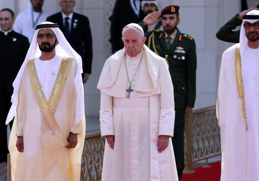 Pope Francis stands next to Vice-President of the United Arab Emirates
