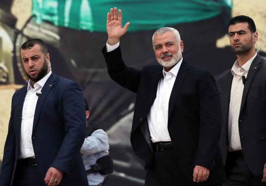 Hamas Chief Ismail Haniyeh gestures during a rally marking the 31st anniversary of Hamas' founding