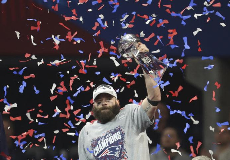 Super Bowl MVP Julian Edelman (11) celebrates with the Vince Lombardi Trophy after Super Bowl LIII