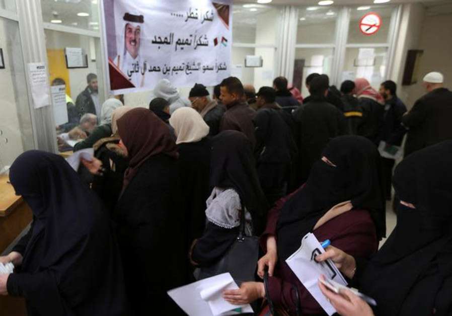 Palestinian Hamas-hired civil servants wait to receive their salaries paid by Qatar