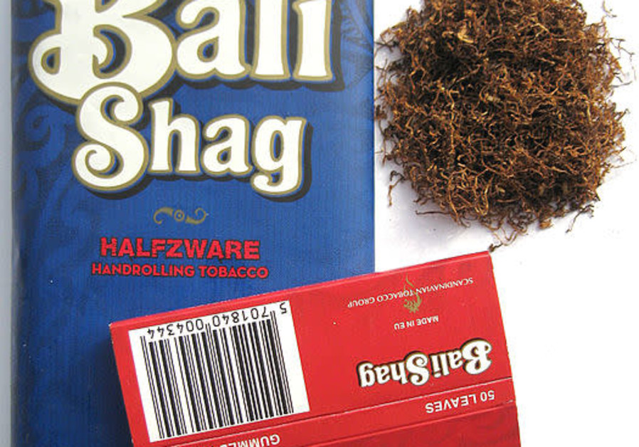 A 40g pouch of Bali Shag Halfzware, Bali Shag Halfzware tobacco and red Bali Shag rolling papers