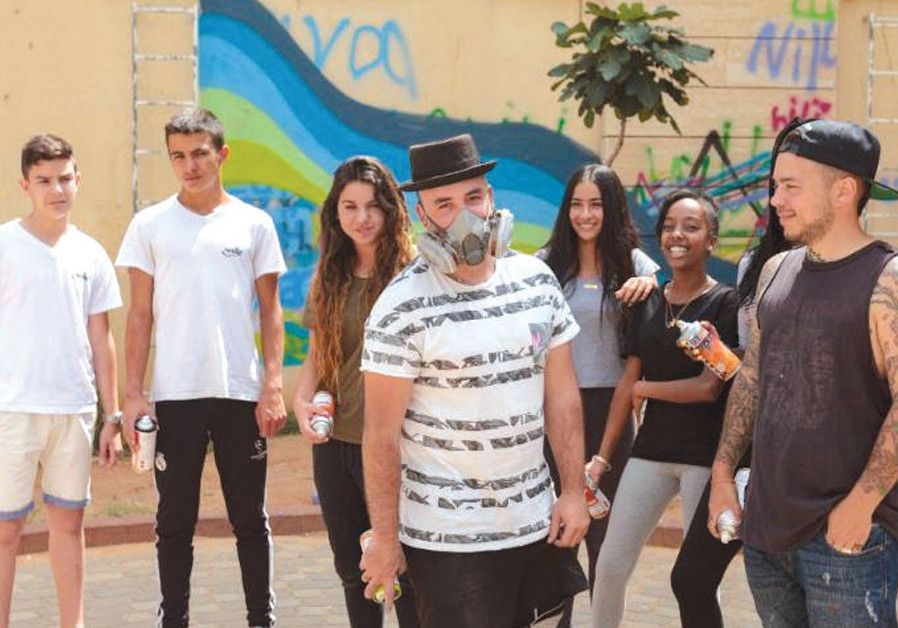 Spray painting a pro-Israeli message with Artists 4 Israel