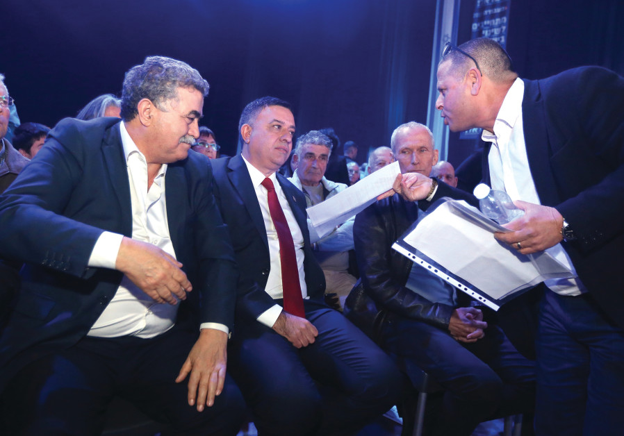 LABOR LEADER Avi Gabbay is harangued by MK Eitan Cabel (right) and MK Amir Peretz