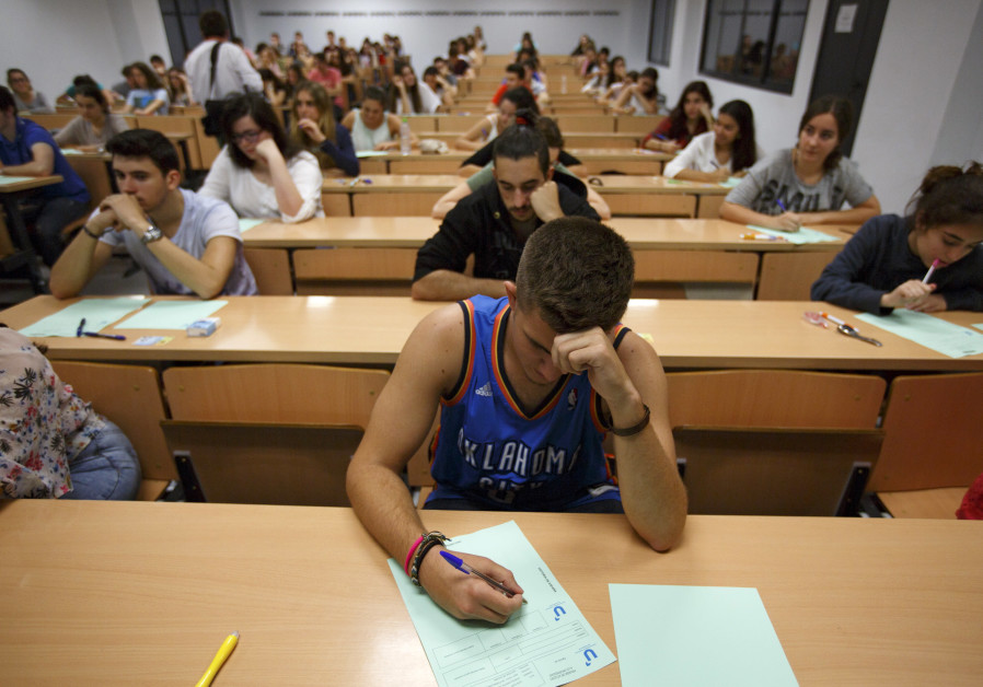 Students take a university entrance examination at a lecture hall in the Andalusian capital of Sevil
