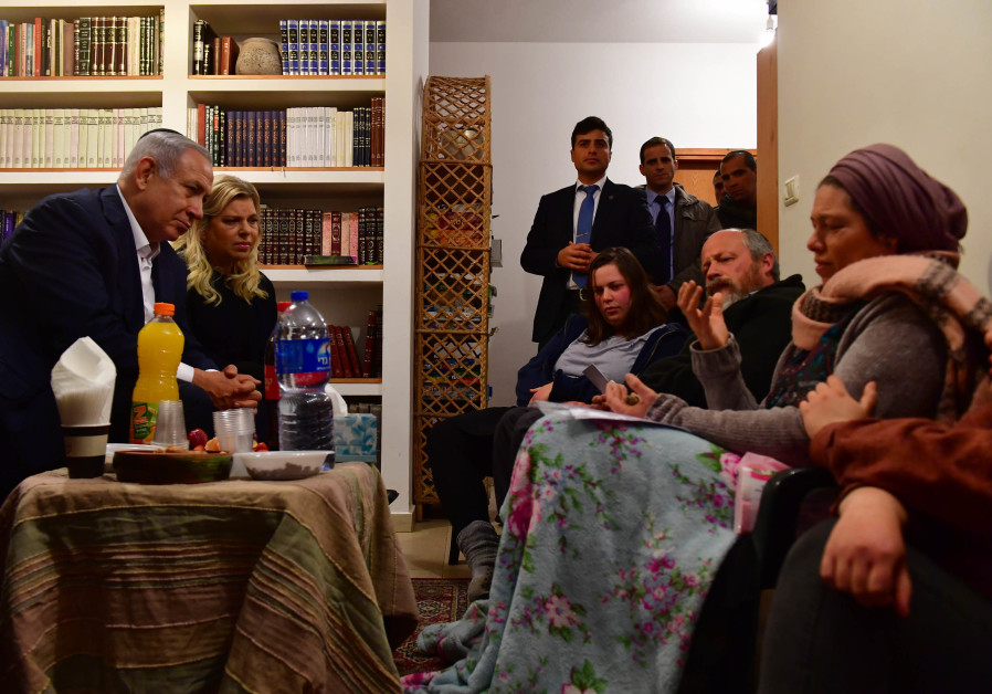 Prime Minister Benjamin Netanyahu and Sarah Netanyahu visit the Ansbacher family on February 10, 201