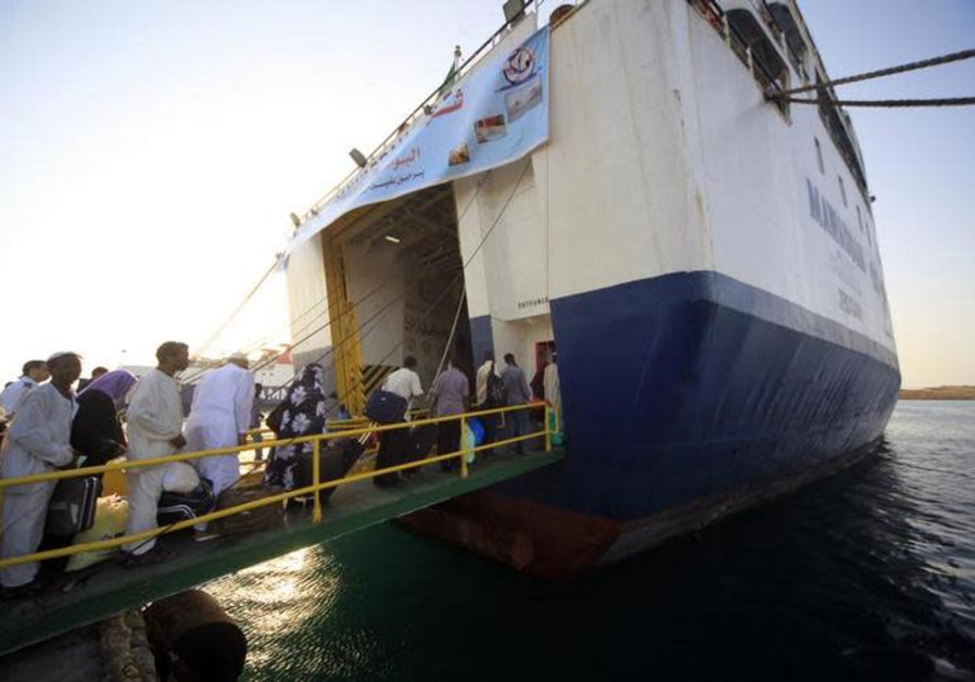 Pilgrims board a ferry at Suakin port in the Red Sea state