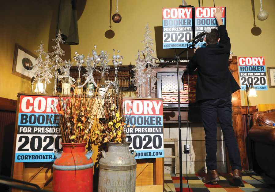 A CORY Booker supporter puts up a placard.