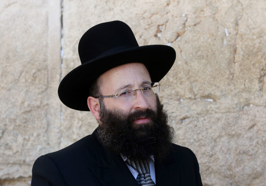 Rabbi Shmuel Rabinowitz, Rabbi of the Western Wall, poses for a photo in front of the holy site