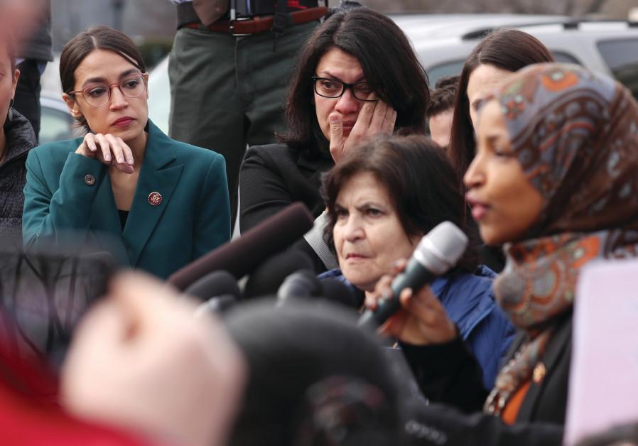 US REPRESENTATIVE Alexandria Ocasio-Cortez and Representative Rashida Tlaib wipe away tears