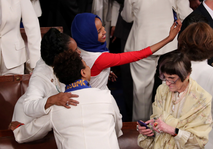 Representatives take selfies ahead of U.S. President Donald Trump's second State of the Union.