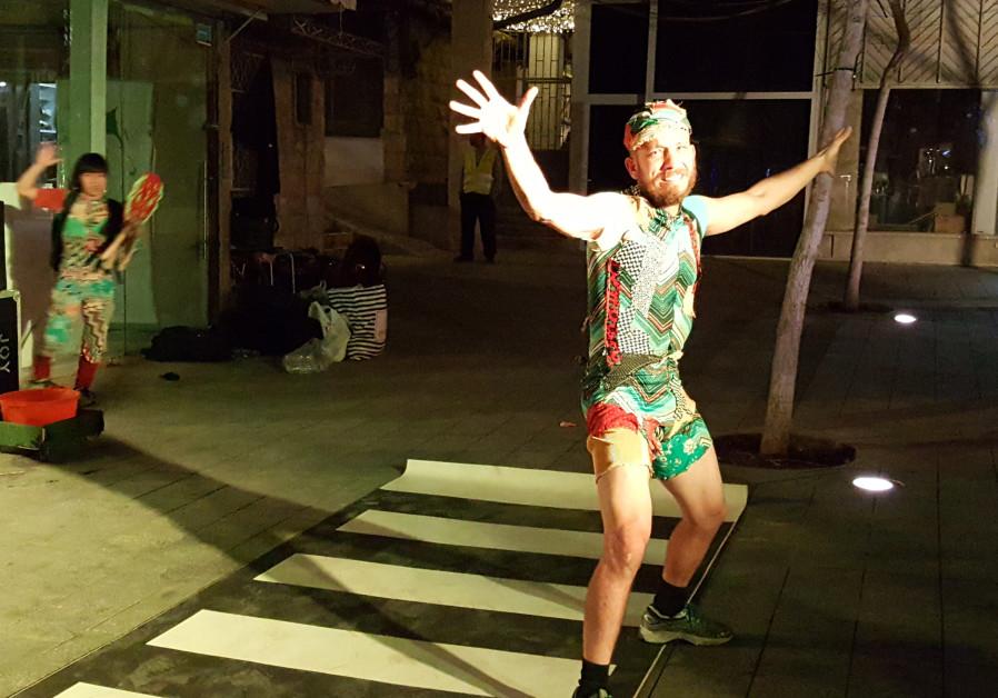 Dror Liberman and Kazuyo Shionoiri perform street theater at Jerusalem's Shaon Horef festival February 4, 2019. Credit: Ben Bresky.