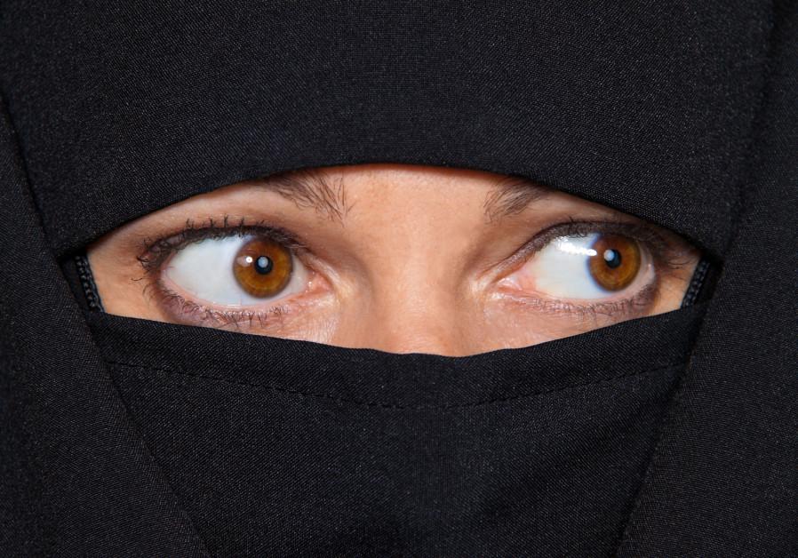 Muslim in a burka.