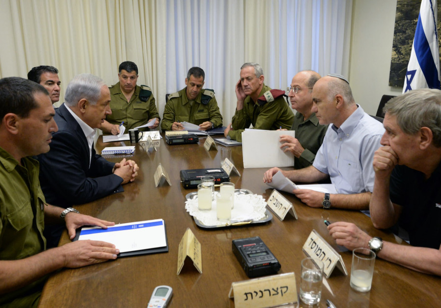 YORAM COHEN (second from right) sits down with (from right) former Mossad chief Tamir Pardo