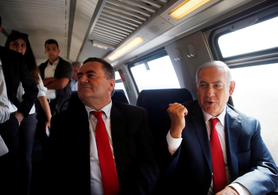 Prime Minister Benjamin Netanyahu (R) sits next to Israel Katz