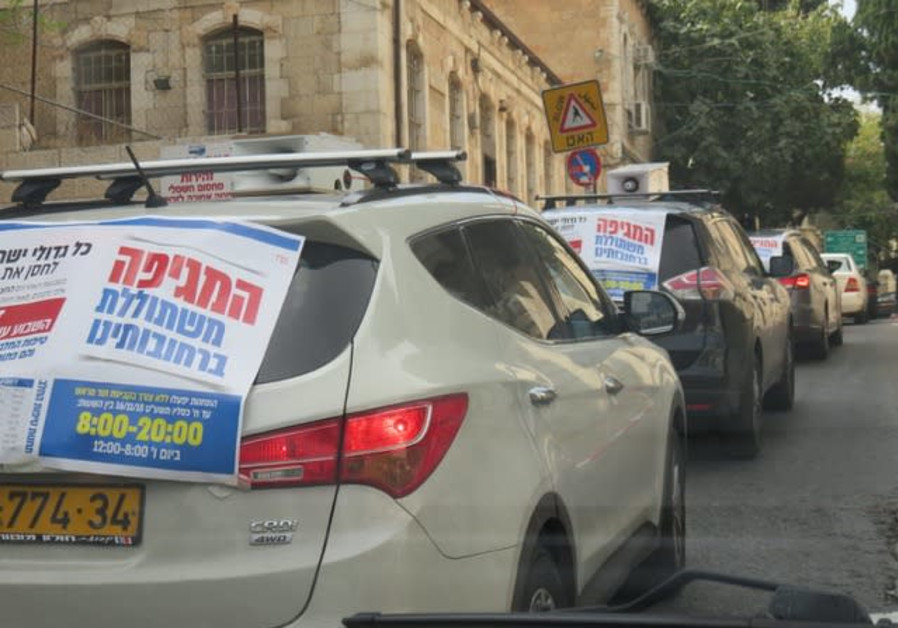 Cars plastered with Yad Avraham posters