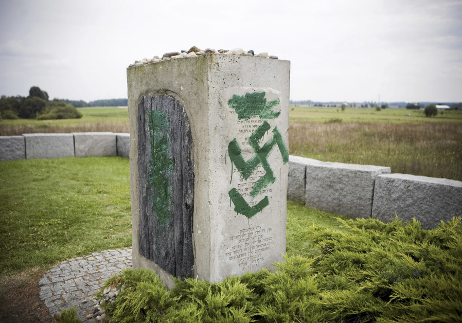 A monument with Nazi swastikas painted over it in Jedwabne